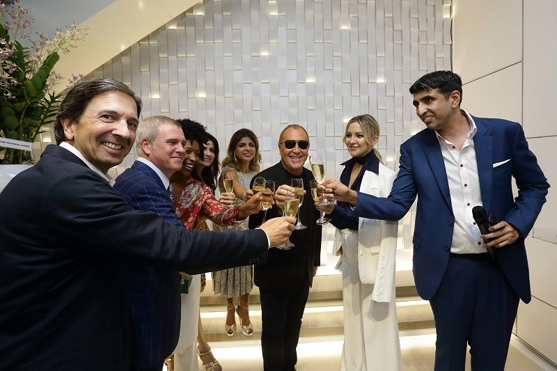 SINGAPORE - NOVEMBER 15:  (L-R) John Idol, Kurt Wagar, Crystal Wagar, Roshan Valiram, Monica Valiram, Michael Kors, Kate Hudson and Mukesh Valiram make a toast during the Michael Kors Mandarin Gallery Flagship Store Opening Cocktail Party at Orchard Road on November 15, 2016 in Singapore.  (Photo by Suhaimi Abdullah/Getty Images for Michael Kors)