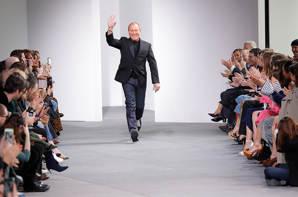 NEW YORK, NY - FEBRUARY 15:  Designer Michael Kors  walks the runway during the Michael Kors Collection Fall 2017 fashion show at Spring Studios on February 15, 2017 in New York City.  (Photo by JP Yim/Getty Images for Michael Kors)
